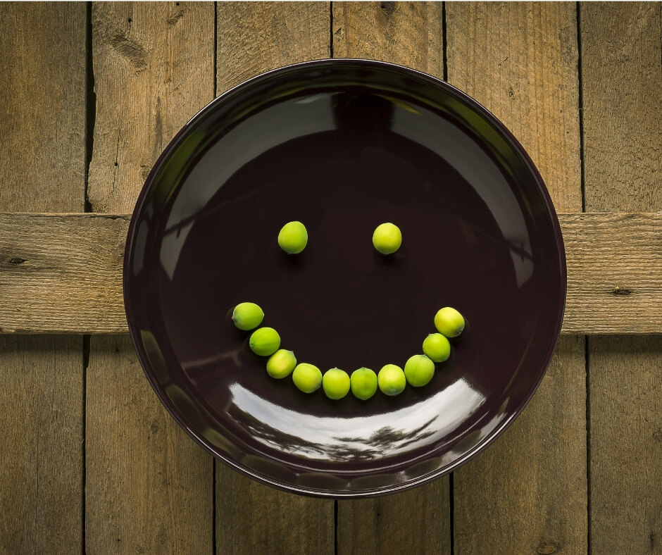 peas in smiley face on plate